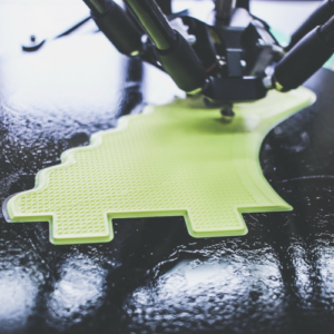Leased 3D Printer creating green fin shape